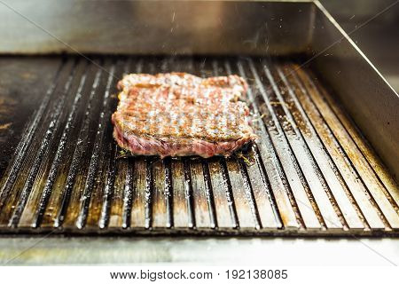 closeup of a steak on grill. Grilled beef steak on the grill, close-up