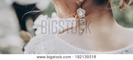Stylish Wedding Bride With Bouquet And Amazing Modern Dress. Bride Posing In Sunny Garden, Earring C