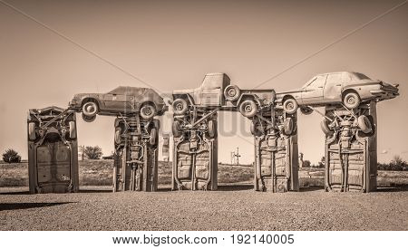 ALLIANCE, NE, USA - MAY 29, 2017:  Carhenge - famous car sculpture  created by Jim Reinders, a modern replica of  England's Stonehenge using old cars., sepia toned image