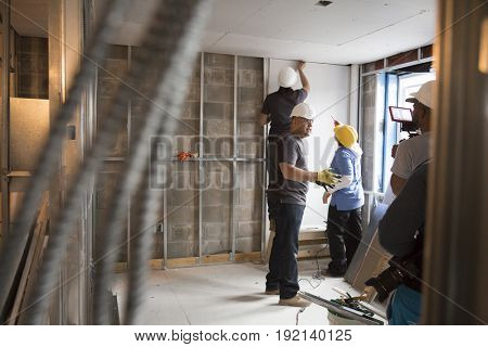 Brooklyn Borough Hall senior staff help Habitat for Humanity New York City on a home building construction project in Brownsville section of Brooklyn during Fleet Week New York, NEW YORK MAY 25 2017.