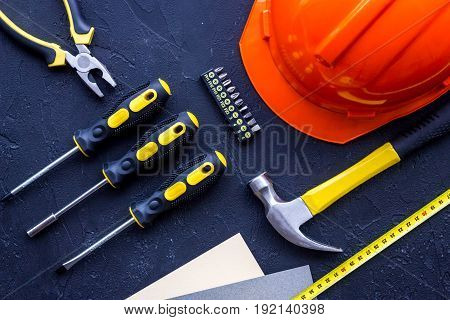 Tools for repairing on black stone desk background top view copyspace.