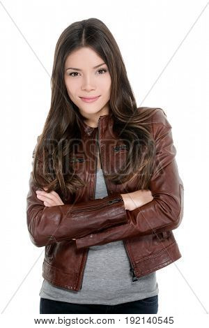 Asian young woman casual moto bike leather jacket portrait isolated on white background. Happy confident model with crossed arms.