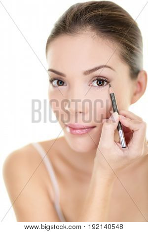 Makeup beauty Asian woman applying brown pencil eyeliner on eye. Face eyes care lifestyle isolated on white background.