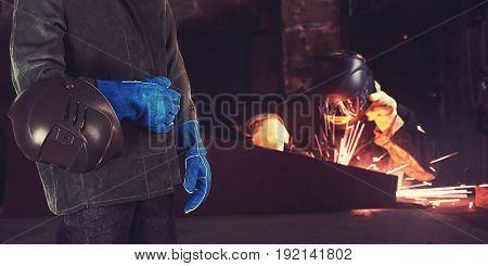 Welder in the workshop at the factory
