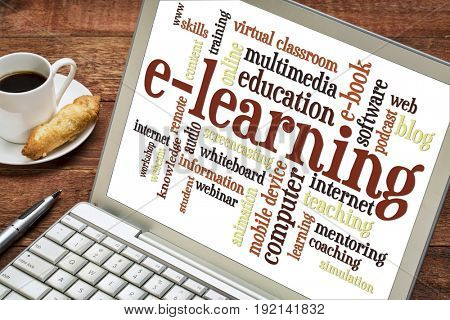 e-learning word cloud on a laptop screen with a cup of coffee, online education concept