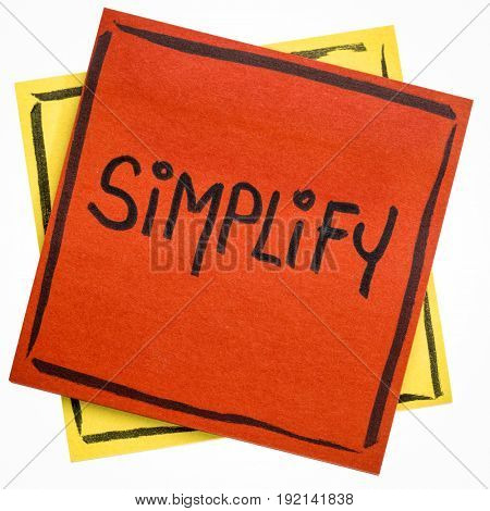 pragmatic or get organized concept, simplify reminder - black ink handwriting on an isolated sticky note