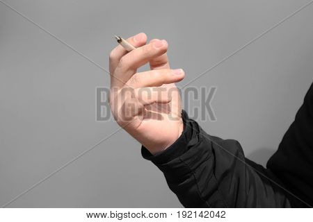 Man smoking weed on color background