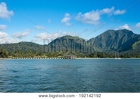 Afternoon from boat trip at Hanalei Bay and pier with the Na Pali coast in the background near Hanalei, Kauai, Hawaii