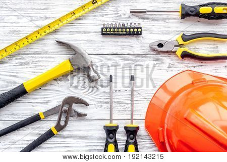 Set of construction tools on grey wooden desk background top view.