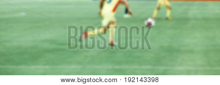 soccer player kicking the ball - blurred background