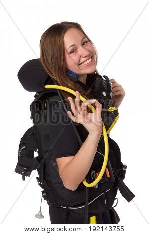 Beautiful woman scuba diver  shows sign OK on a white background.