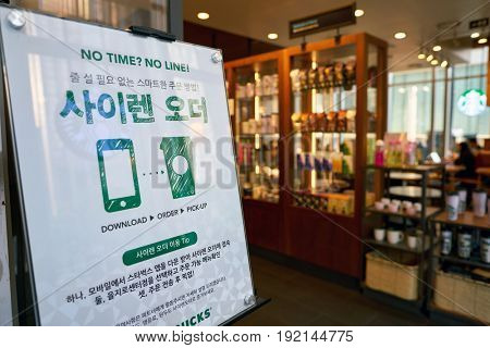 SEOUL, SOUTH KOREA - CIRCA MAY, 2017: close up shot of a poster at Starbucks in Seoul. Starbucks Corporation is an American coffee company and coffeehouse chain.