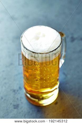 Cold Pilsner Beer in a glass mug