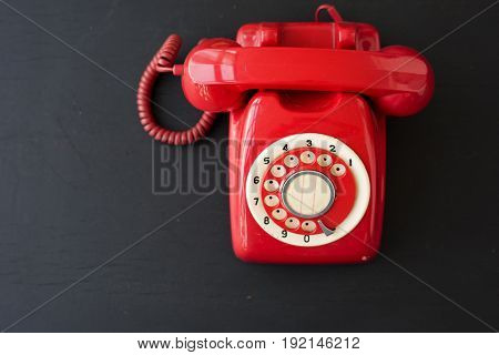 Red Retro Vintage Telephone on Black Background