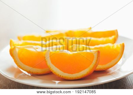 fresh orange slices on a plate