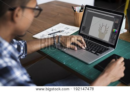 Graphic designer working with laptop and mousepad