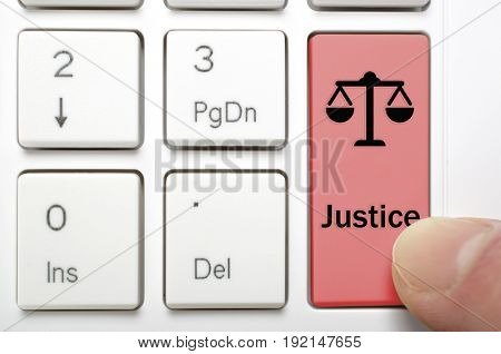 Red justice key on keyboard