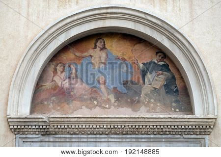 ROME, ITALY - SEPTEMBER 01: Fresco of Saint Dominic with Christ, tympani over the side entrance of Basilica Santa Maria Sopra Minerva, Rome, Italy on September 01, 2016.