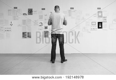 Man standing read information documents on the wall