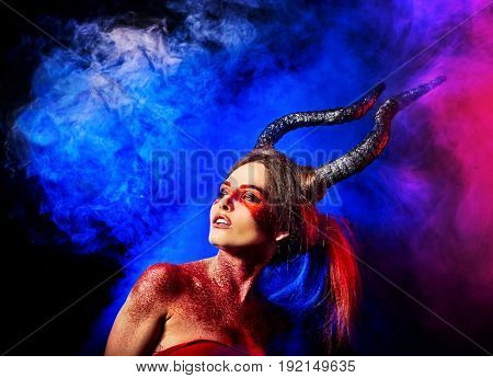 Mad satan woman on black magic ritual of in hell. Witch reincarnation mythical creature on Sabbath. Devil on Halloween. Zodiac astrology. Make-up for night club. Visions of drug addict.
