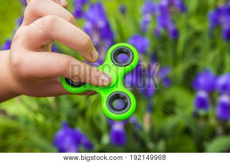 Rotating green spinner in hand