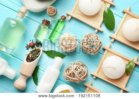 Spa composition with tea tree oil on blue wooden background