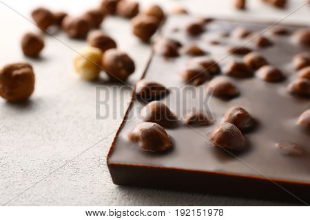 Chocolate bar with nuts on table