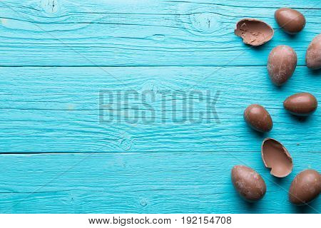 Chocolate eggs on blue background