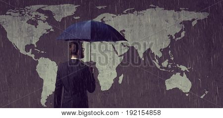 Businessman with umbrella standing over world map background. Business, crisis, failure, concept.