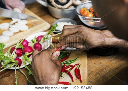 Closeup of hands with chili pepper prepare to cook