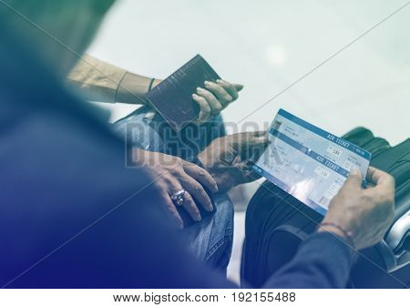 Senior adult couple with boarding pass at the  airport