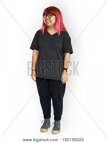 Young adult asian girl standing and smiling studio portrait