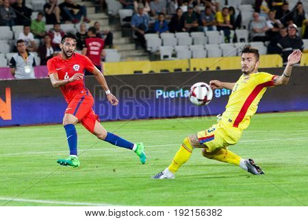 CLUJ-NAPOCA, ROMANIA - 13 JUNE 2017:Chile's Mauritio Isla (L) fights the ball with Romania's Alin Tosca during the Romania vs Chile friendly, Cluj-Napoca, Romania - 13 June 2017
