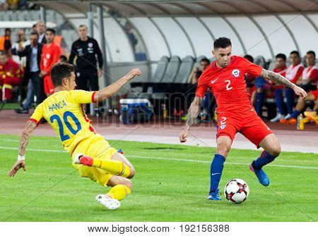 CLUJ-NAPOCA, ROMANIA - 13 JUNE 2017:Romania's Sergiu Hanca (L) fights the ball with Chile's Eugenio Mena during the Romania vs Chile friendly, Cluj-Napoca, Romania - 13 June 2017