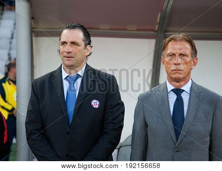 CLUJ-NAPOCA, ROMANIA - 13 JUNE 2017:Juan Antonio Pizzi, Chile's coach and Christoph Daum, Romanian national football team head coach during the national anthems ahead of the Romania vs Chile friendly