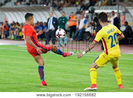 CLUJ-NAPOCA, ROMANIA - 13 JUNE 2017:Alexis Sanchez (L) of Chile fights the ball with Sergiu Hanca of Romania during the Romania vs Chile friendly, Cluj-Napoca, Romania