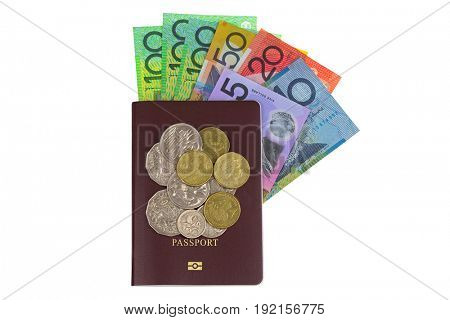 Australian dollar banknote (AUD) and coins on red brown Passport isolated on white background