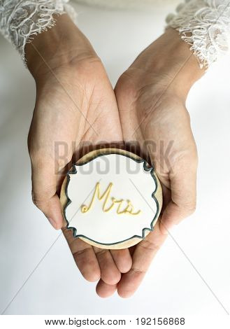 Woman hands holding showing wedding cookies