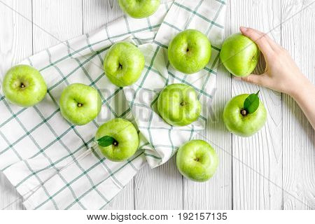 summer food with green apples on white table background top view