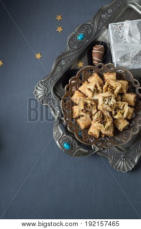 Assorted delicious Baklava sweet served in an ornamental tray. Special sweet treat and gifts on the occasion of Eid festival.