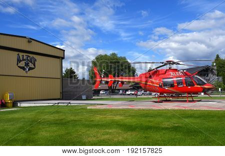 KALISPELL, MONTANA, USA - June 19, 2017: ALERT air ambulance helicopter on the helipad at Kalispell Regional Medical Center.