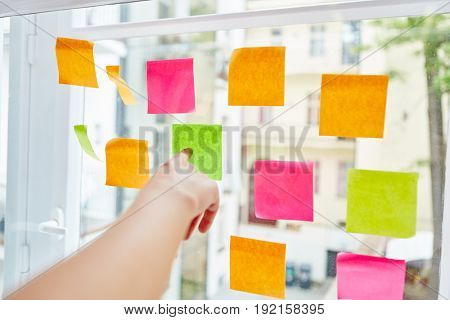 Hand pointing sticky note with creative planning for workshop