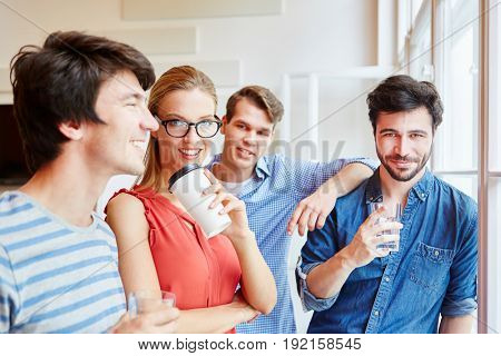 Successful start-up team taking a coffee break