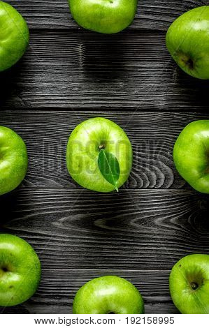 Organic fruits with green apples pattern on dark desk background top view