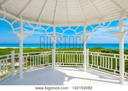 View of the beautiful beach of Varadero in Cuba from the windows of a white seaside wooden pavilion
