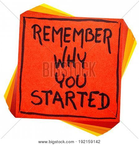 Remember why you started - handwriting in black ink on an isolated sticky note