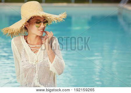 Portrait of beautiful tanned sporty slim woman relaxing in swimm