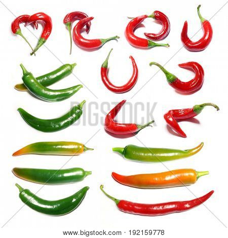 Collection of red and green peppers on a white background