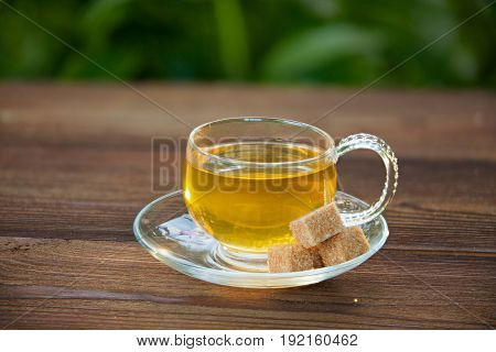 Crystal Cup With Green Tea On Table