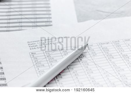 business accounter work with taxes and pen on white office desk background